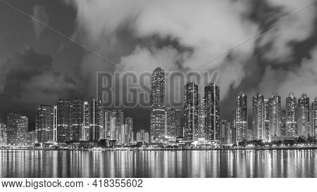 Panorama Of Skyline And Harbor Of Midtown Of Hong Kong City At Dusk