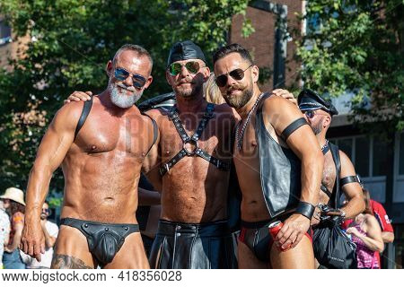 Barcelona - Spain. June 29, 2020: Trio Of Mature Gay Men In Sex Club Suits Consisting Of Leather Ves