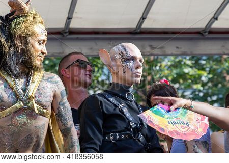 Barcelona - Spain. June 29, 2020: Two Contrasting Participants In The Parade. One Is Pan In A Golden