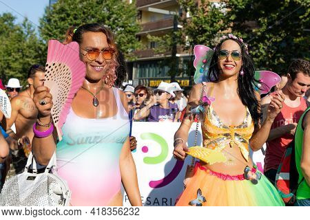 Barcelona - Spain. June 29, 2020: Two Parade Participants In Elegant Stylish Dresses With Handbags A