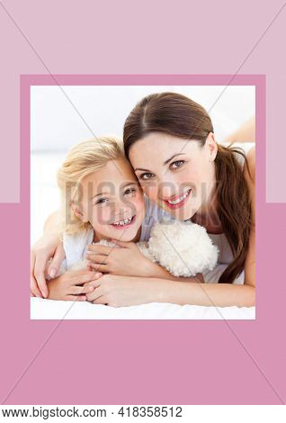 Portrait of mother and daughter smiling against dual tone pink background frame. mothers day template background design concept