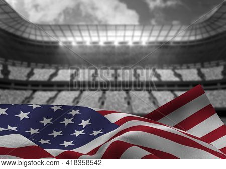 Digital composite image of american flag waving against sports stadium in background. patriotism and sports concept