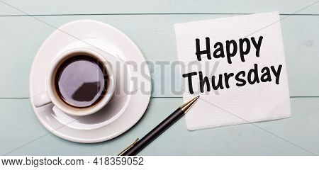 On A Light Blue Wooden Tray, There Is A White Cup Of Coffee, A Handle And A Napkin That Says Happy T