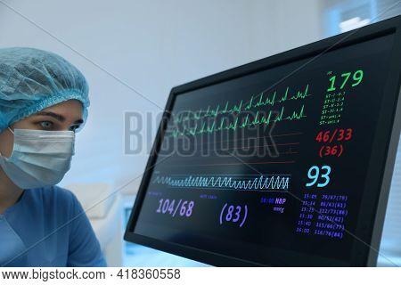 Nurse Near Monitor With Cardiogram In Hospital