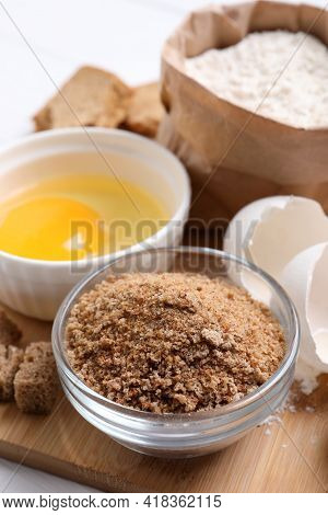 Fresh Breadcrumbs, Flour And Egg On Table