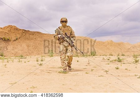 Fully Equipped And Armed Special Forces Soldier In The Desert, Army Anti-terror Missions Concept.
