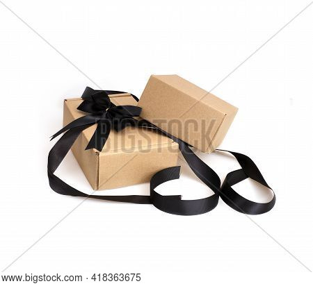 Two Craft Boxes With Black Bow And Ribbon Isolated On White Background