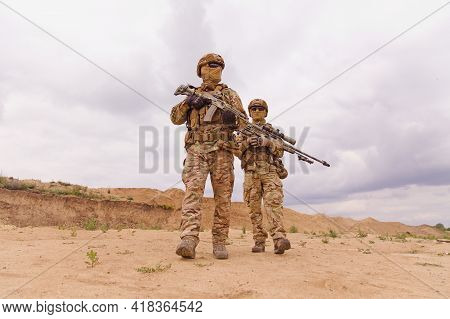 Two Special Forces Rangers During The Military Operation In The Desert