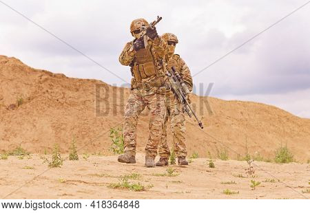 Equipped And Armed Special Forces Soldiershooting On The Battlefield. Concept Of Military Anti-terro