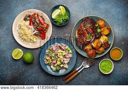 Set Of Assorted Dishes Of Peruvian Cuisine: Beef And Peppers Lomo Saltado, Peruvian Ceviche With Fis