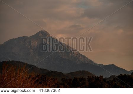 Incredible View Of The Hills And Mountains Against The Backdrop Of Cloudy Sky