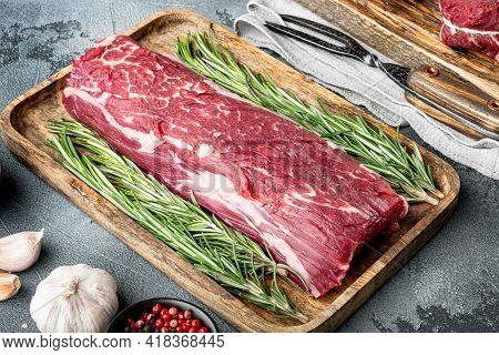 Fresh And Raw Beef Meat. Whole Piece Of Tenderloin With Steaks Set, On Gray Stone Background