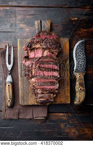 Sliced Grilled Rib Eye Beef Steak Beef Marbled Rare Set, On Wooden Serving Board, With Meat Knife An