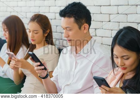 Group Of Multiracial Friends Using Cellular, Teenagers Texting Mobile Phone Messages, Concept Of Stu