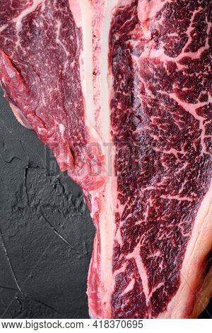 Italian Florentine T Bone Dry Aged Beef Meat Steak Set, On Black Stone Background, Top View Flat Lay
