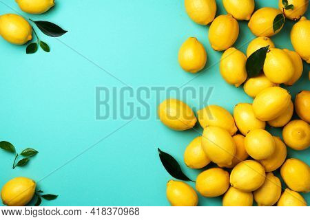 Lemons Frame On Blue Background. Immune System Booster. Copy Space. Top View. Flat Lay. Citrus Fruit