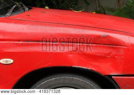 Peeling Paint On An Old Damaged Car