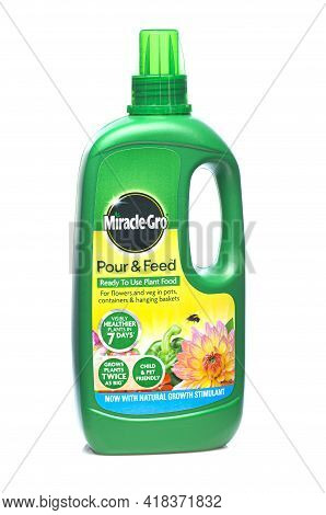 Swindon, Uk - April 26, 2021: Bottle Of Miracle Gro Pour And Feed Plant Food On A White Background