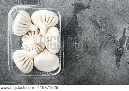 Manti Or Manty Dumplings, Popular Asian Dish Set, In Plastic Tray, On Gray Stone Background, Top Vie