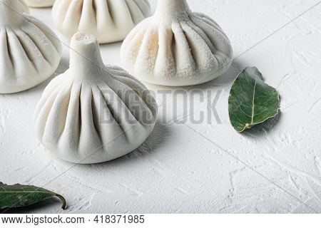 Stuffed Dumplings, Manti Of Dough And Minced  Set, On White Stone  Surface, With Copy Space For Text