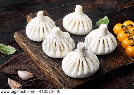 Uncooked Baozi Chinese Dumplings. Azian Dumplings Set, On Old Dark  Wooden Table Background