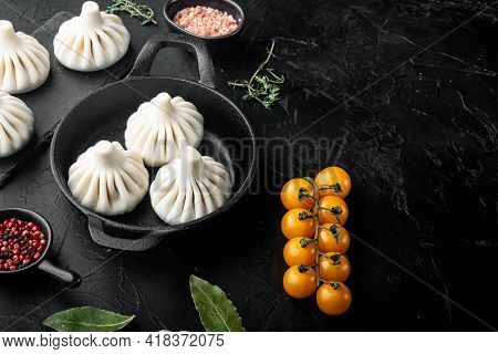 Manti Or Manty Dumplings, Popular Asian Dish Set, In Frying Cast Iron Pan, On Black Stone Background