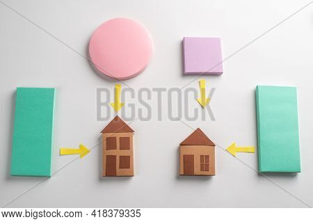 Paper Houses, Circle, Rectangles And Arrows On White Background
