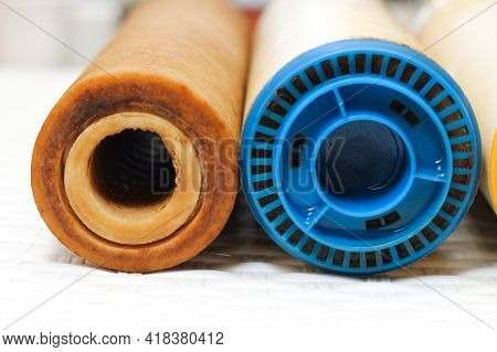 Two Replaceable Used Water Filters. Replaceable Dirty Filters For Filtration Of Reverse Osmosis Wate