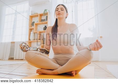 Peaceful Woman With Prosthesis Arm Meditates In Sunny Room