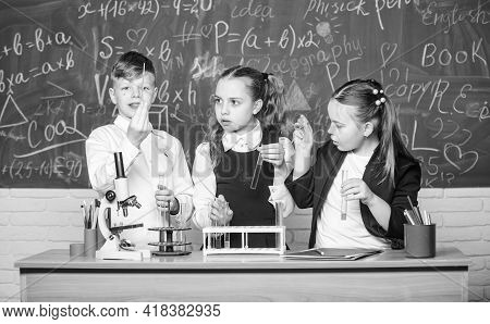 Basic Chemical Reactions. Group School Pupils Study Chemistry In School. Boy And Girls Enjoy Chemica