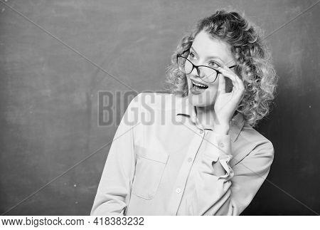 Playful Teacher. Woman School Teacher Shy And Pretty Lady Wear Eyeglasses Chalkboard Background. Ado