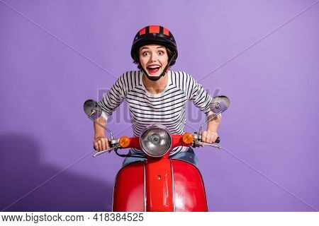 Photo Of Excited Crazy Girl Ride Retro Moped Surprised Look Camera Wear Helmet Striped Shirt Isolate