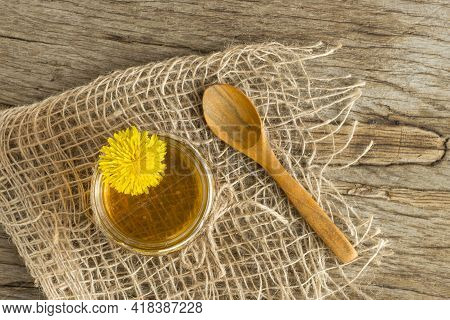 Homemade Delicious Dandelion Jam On A Wooden Table With Yellow Dandelions. Dandelion Flower Syrup. U