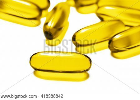 Yellow Capsules Isolated On White. Medicine Healthcare Background. Drugs Dose Tablet. Painkiller Pil