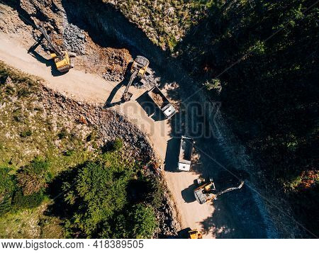 Heavy Machinery Works In The Extraction Of Rock. View From Drone