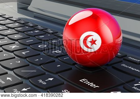 Tunisian Flag On Laptop Keyboard. Online Business, E-education, Shopping In Tunisia Concept. 3d Rend