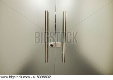 Glass Frosted Door With A Metal Handle. Glass Door. Frosted Glass Background
