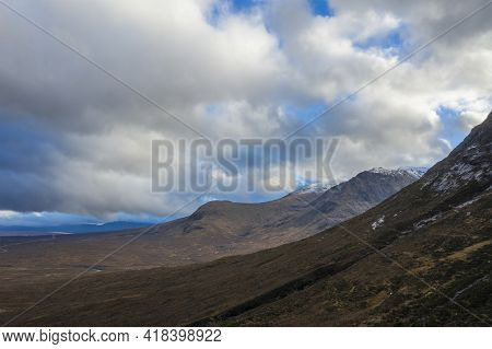 Flying Drone Dramatic Landscape Image Of Mountains Rivers And Valleys In Glencoe In Scottish Highlan