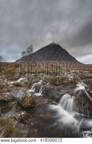 Stunning Landscape Image Of Buachaille Etive Mor Waterfall In Scottish Highlands On A Winter Morning
