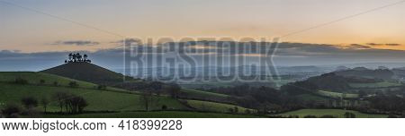 Beautiful Vibrant Sunrise Panoramic Landscape Image Of Colmer's Hill In Dorset On A Spring Morning