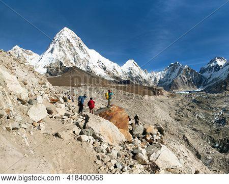 Mount Kala Patthar And Mount Pumo Ri With Tourists Near Gorak Shep Village On The Way To Everest Bas