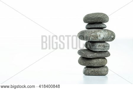 Pebble Pyramid In Balance Are Isolated On A White Background. Stones Pyramid Symbolizing Zen, Harmon