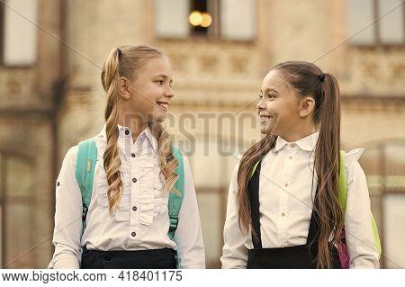 Soulmate Friends. Cute Schoolgirls With Long Ponytails Looking Charming. Ending Of School Year. Chee