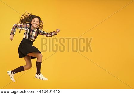 Happy Childrens Day. Jump Concept. Break Into. Feel Inner Energy. Girl With Long Hair Jumping On Yel
