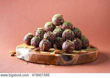 Raw Energy Balls With Matcha Tea Powder On Wooden Board On Beige Background. Raw Vegan, Vegetarian S
