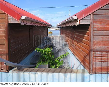 Detail Of Caribbean Houses In A Fishing Port In The French West Indies. Tropical Architecture And Co