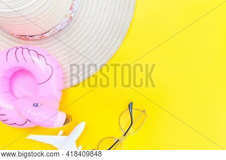 Summer Beach Composition. Minimal Simple Flat Lay With Plane Sunglasses Hat And Inflatable Flamingo