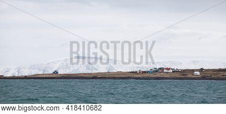 Reykjavik, Iceland, Coastal Panoramic Landscape. Snowy Mountains Under Cloudy Sky