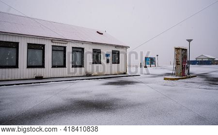 Gas Station And On An Icy Road Duiring Heavy Snow Storm. Iceland