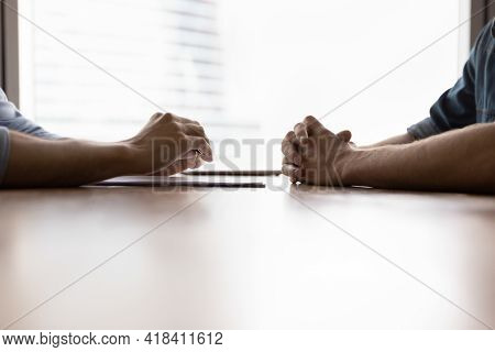 Close Up Of Male Rivals At Office Negotiations